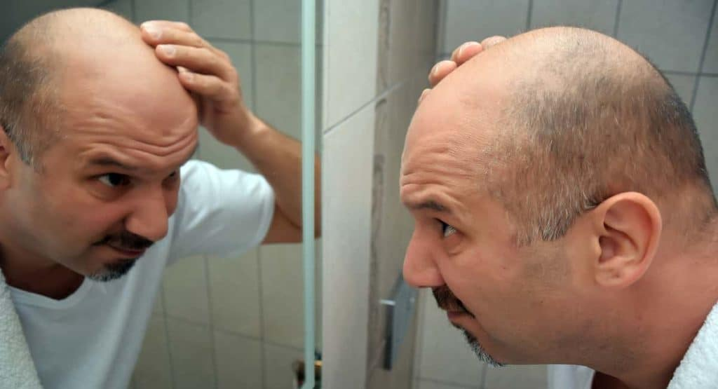 Gone Today, Hair Tomorrow: A Look at the Newest Baldness Cures on the Market